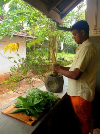 Chopping Fresh garden herbs the traditional way to make the heat pack